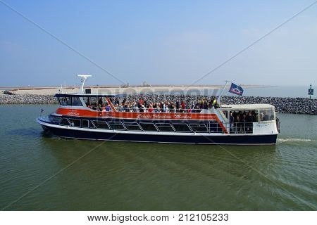 Marker Wadden, Lelystad, The Netherlands - September 24, 2017: Passenger ferry Ms. IJsselmeer carrying passengers in the harbor of Marker Wadden.