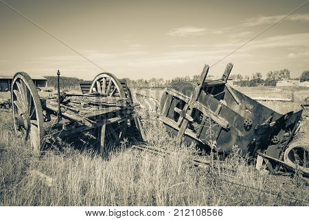 Vintage Farm Equipment - old chariot and an old hay baler
