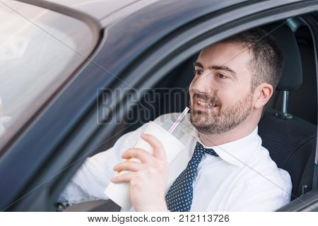 Man Drinking  And Driving Seated In Car
