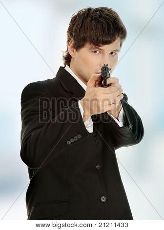 Businessman aiming with handgun.