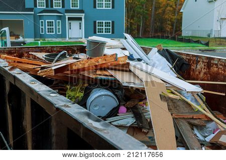 Loaded dumpster near a construction site home renovation dumpster filled with building rubble dumpster poster