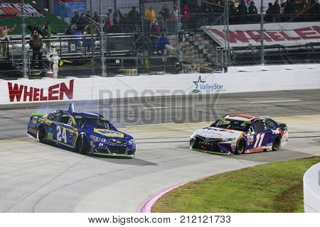 October 29, 2017 - Martinsville, Virginia, USA: Chase Elliott (24) and Denny Hamlin (11) get together during the First Data 500 at Martinsville Speedway in Martinsville, Virginia.