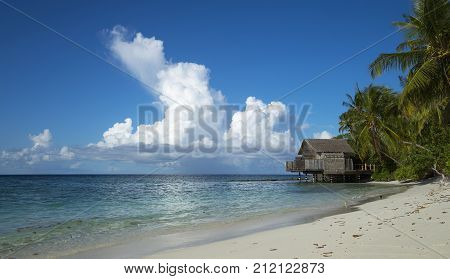 Tropical Beach. Ocean Waves And Cloudy Sky Background. White Sand And Crystal-blue Sea. Ocean Water