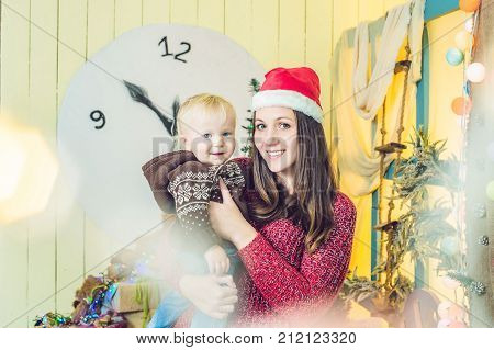Portrait Of Happy Mother And Adorable Baby Celebrate Christmas. New Year's Holidays. Toddler With Mo