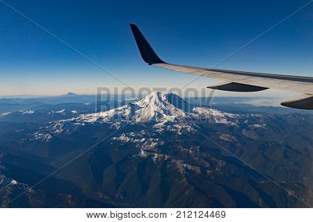 Mt Rainier is seen out the window of a flight bound for Seattle
