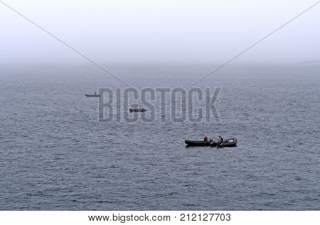 Readying the boats in the Fog near the Lower Savage Islands near Baffin Island in Nunavut