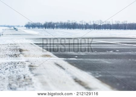 Winter road. Drifts, snow, tire tread imprint.