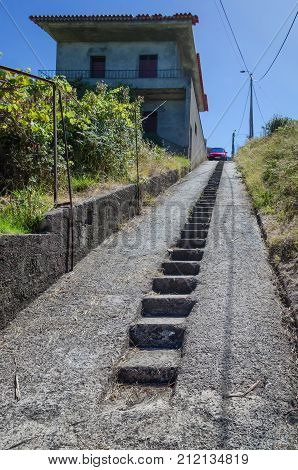 Unusual car parking in Madeira's mountains. People who live high in mountains have to build unusual parking places if they want to park their cars near own houses.