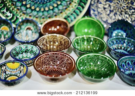 9 November 2013 Hand made souvenirs traditional tableware Shah-i-Zinda - UNESCO World Heritage Samarkand Uzbekistan.