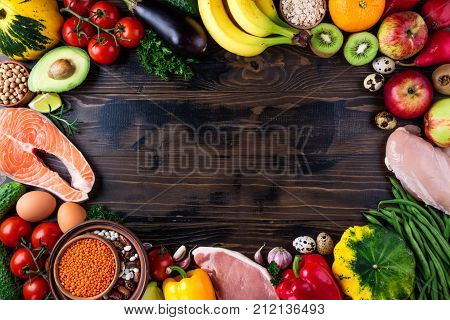 Selection of healthy food. Fresh organic vegetables fruits meat and fish. Healthy eating and healthy life concept. Top view copy space