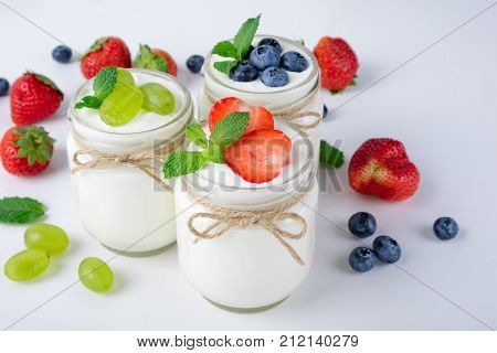 Fresh yogurt. Breakfast with yogurt with fruits and berries. Healthy food concept