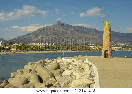 Beacon in Puerto Banus on September 20 2016 in Marbella Costa del Sol Malaga Province Andalusia Spain Western Europe. Puerto Banús is home to three beaches: Playa Nueva Andalucia Playa Puerto Banus (also known as Playa de Levante) and Playa del Rio Verde.