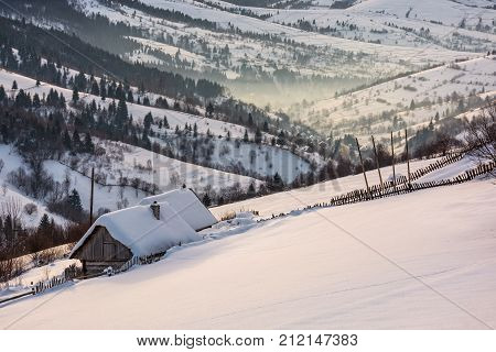 Woodshed On Hillside In Deep Snow