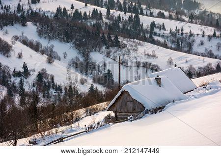 Woodshed On Hillside In Deep Snow