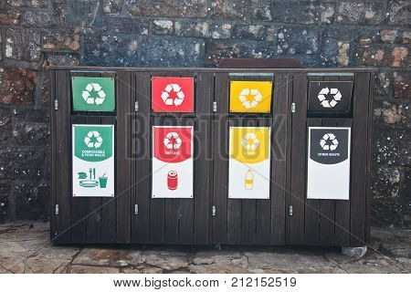 Boxes for separate waste collection. Trash. Garbage tank. Waste. Containers for plastic glass and other waste. South Africa. Reserve table mountain Cape town
