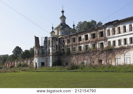 Crumbling walls of the monastery Spaso-Sumorin and dome of the Cathedral Ascension of the Lord in the town of Totma, Vologda Region, Russia