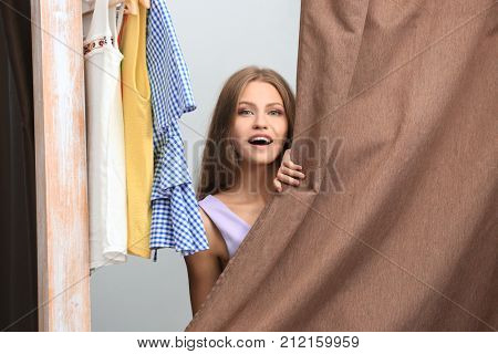 Young woman trying on clothes in dressing room
