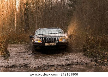 28.10.2017. Arkhangelsk tract. Leningrad region. Russia. check out offroad jeep Cherokee and Wrangler. The Cherokee is a compact SUV manufactured by Chrysler