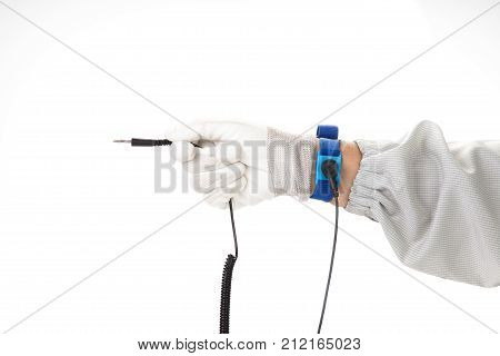 Bracelet on the hand of a man wearing ESD cloth and glove static resistance (ESD) bracelet or ground equipment anti-static used to safely ground is working. electronic devices