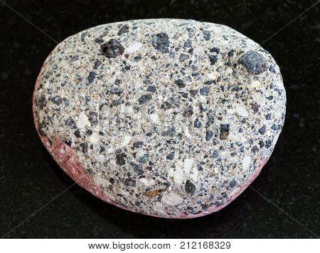 Pebble Of Gray Arkose Sandstone On Dark Background