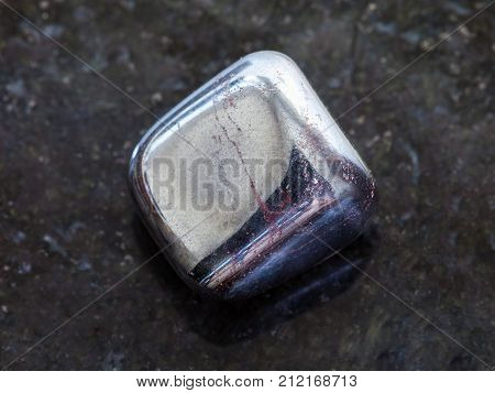 Tumbled Hematite Stone On Dark Background