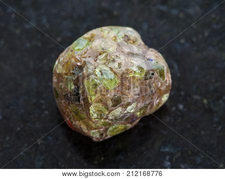 Polished Peridot Gemstone On Dark Background