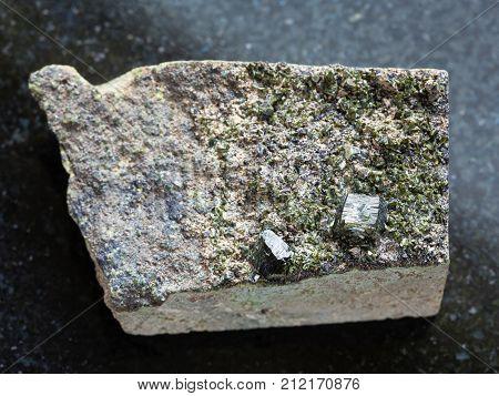 Raw Green Crystals Of Epidote On Rock On Dark