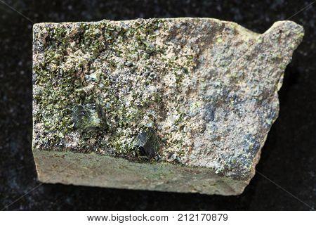 Rough Green Crystals Of Epidote On Rock On Dark