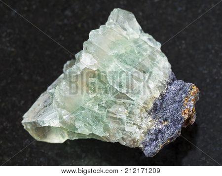 Raw Crystalline Fluorite Gemstone On Dark