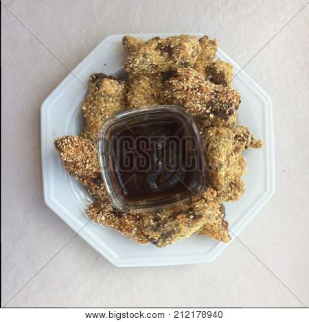 Fried chicken with barbecue sauce in the bowl