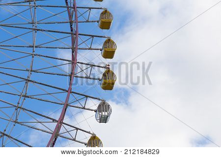 Path of funny ferris wheel against blue sky background
