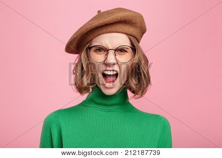 Furious Irritated Woman Screams In Despair, Frowns Face, Being Disturbed By Something, Quarrels With