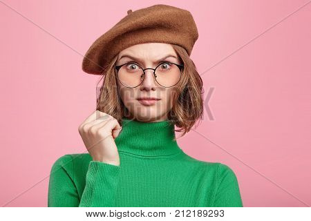 Perplexed Pleasant Looking Clueless Female Being In Stupor As Doesn`t Understand Question, Has No An