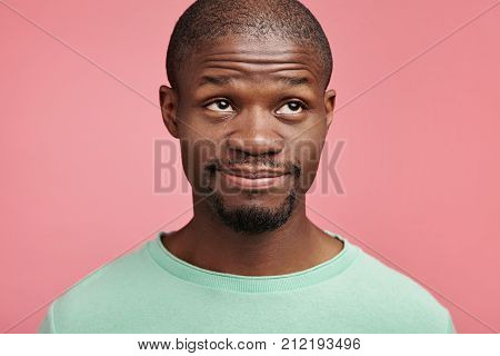 African American Male With Beard And Mustache, Looks Puzzled And Thoughtful Up, Thinks Over His Plan