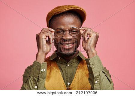 Smiling Happy Dark Skinned Stylish Male Enterpreneur Rejoices Success At Work, Recieves High Profit