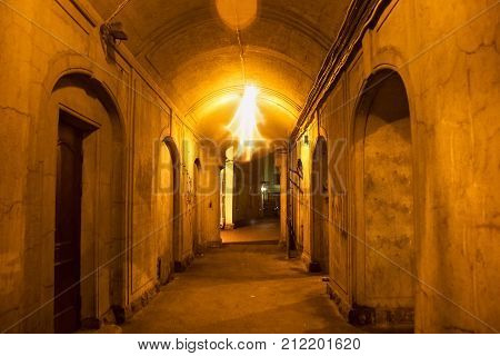 Typical aisle in aged courtyard in the old district of Saint Petersburg (former Leningrad) at night. St. Petersburg was founded by Tsar Peter the Great on 1703 and was the capital of imperial Russia.