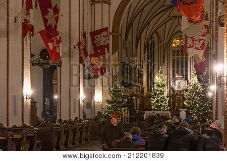 WARSAW, POLAND - JANUARY 01, 2016: Interior of the gothic St. John's Archcathedral in Christmas decoration. Originally built in the XIV century but in 1944 was ruined and rebuilt after the war.
