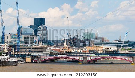 Construction works along River Thames bank, London, England