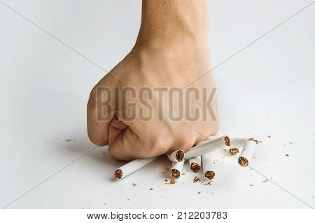 Men Hand Crushed Some Cigarettes,