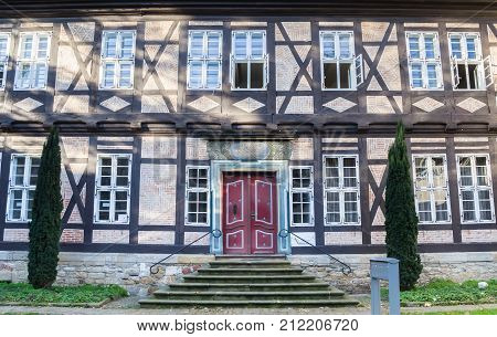GOSLAR, GERMANY - OCTOBER 16, 2017: Red door on a historic half-timbered house in Goslar Germany