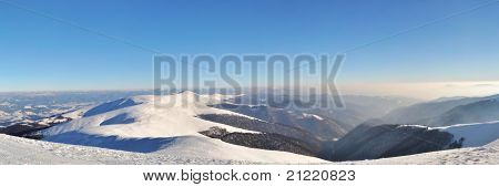 Snowy Mountain Ridges With Fir Tree Forest Panorama