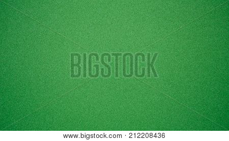 Abstract Grunge Decorative Green Texture. Granular Christmas Paper Background With Copy Space for design. Wide Screen bright Wallpaper