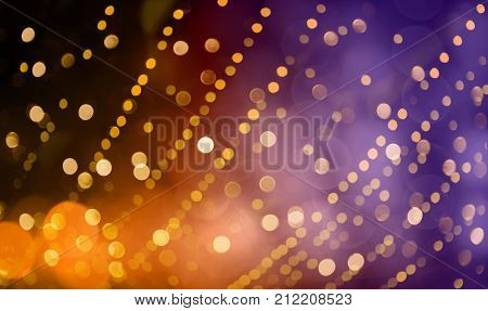 Bright colorful Holiday background with decorative pattern of Gold spots. Texture of scattering of sparkling bokeh light. Festive Red Yellow Purple Wallpaper