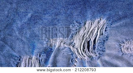 Hole And Threads On Denim Jeans
