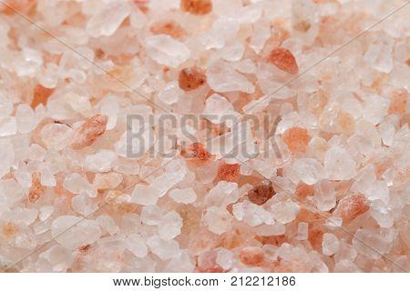Himalaya salt background and close up. Pink and orange coarse crystals.