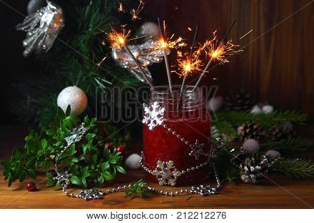 cranberry smoothie with sparklers and Christmas tree