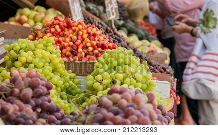 Grapes, Cherries And Other Fruits For Sale At Mahane Yehuda Market, Popular Marketplace In Jerusalem