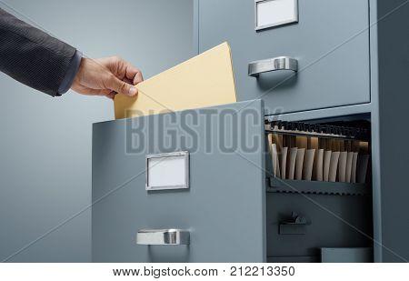 Office Clerk Searching Files