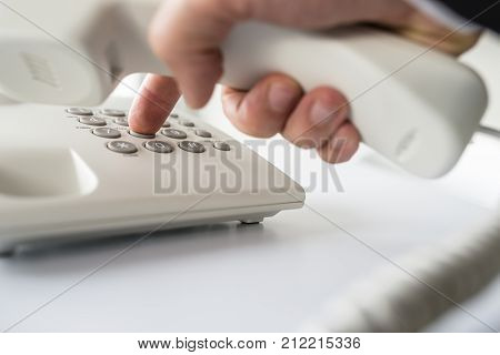 Closeup Of Businessman Making A Telephone Call