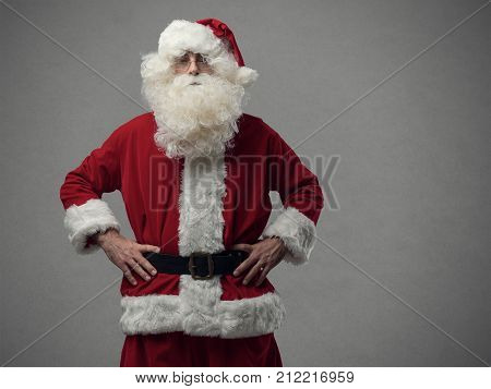 Confident Proud Santa Posing With Arms Akimbo